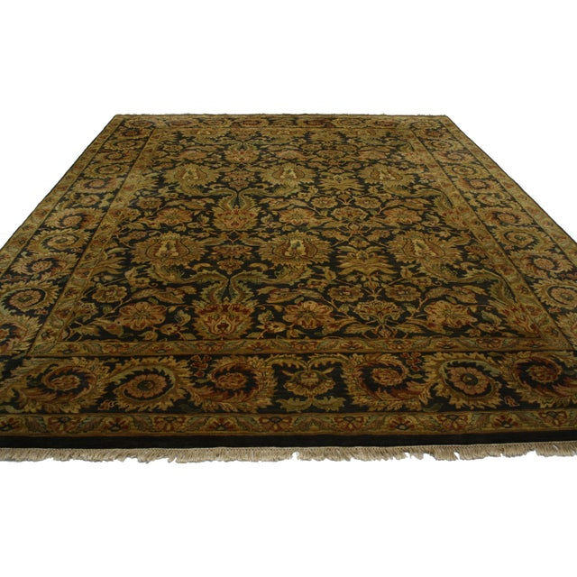 Midcentury rug hand-knotted in India. Features a traditional composition characterized by an allover pattern.
