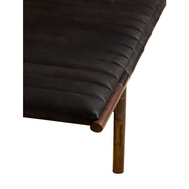 Ebonized rosewood daybed in ribbed Horween leather with blackened brass frame. Designed by Ben Erickson for Erickson...