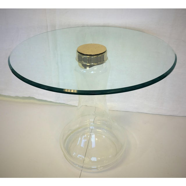 This Sarreid Ltd. made side table is hand-blown with a brass cap securing the beveled glass top to base. It is in...