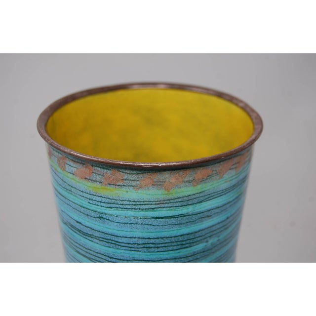 Large multicolored enamel over copper vase, circa 1966. Vase has a silver plated rim, and is signed. Most likely Japanese...