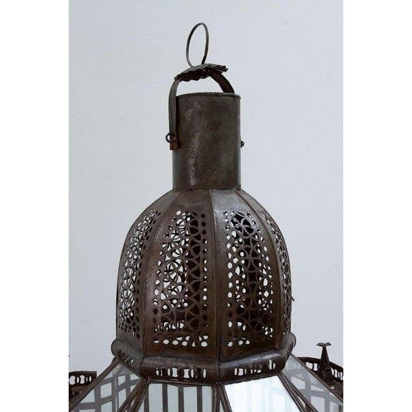 Wonderful vintage Moroccan glass lantern. Intricate handcrafted hurricane candle lamp with Moorish design details. Bronzed...