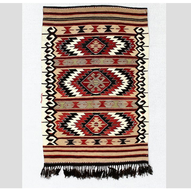 This beautiful vintage Turkish kilim rug is woven with shades of cream, black, beige, and red. Finished with hand knotted...