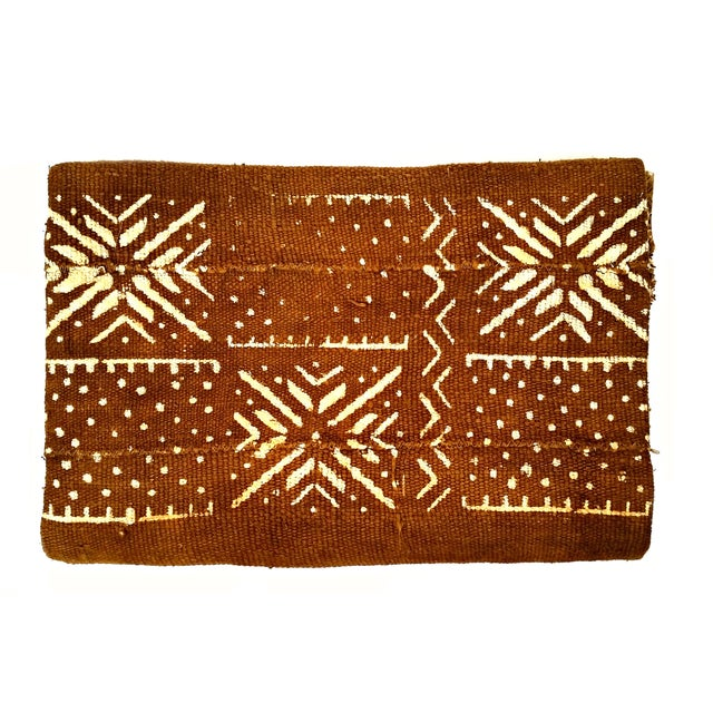 Brown/rust colored African mudcloth fabric is handwoven and made one at a time. They're great for draping at the foot of...