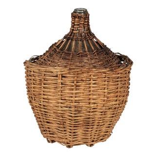 French Glass Demijohn Bottle in Woven Basket For Sale