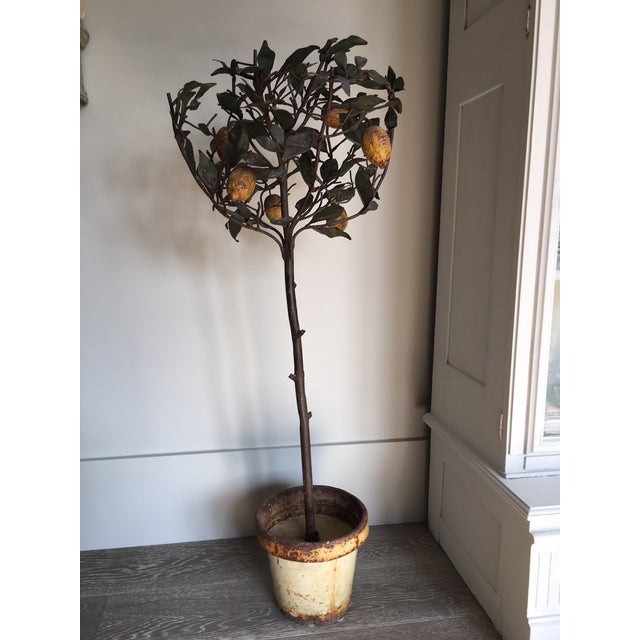 Antique Italian tole lemon topiary. The topiary including stem is removable from the base. It is very heavy.
