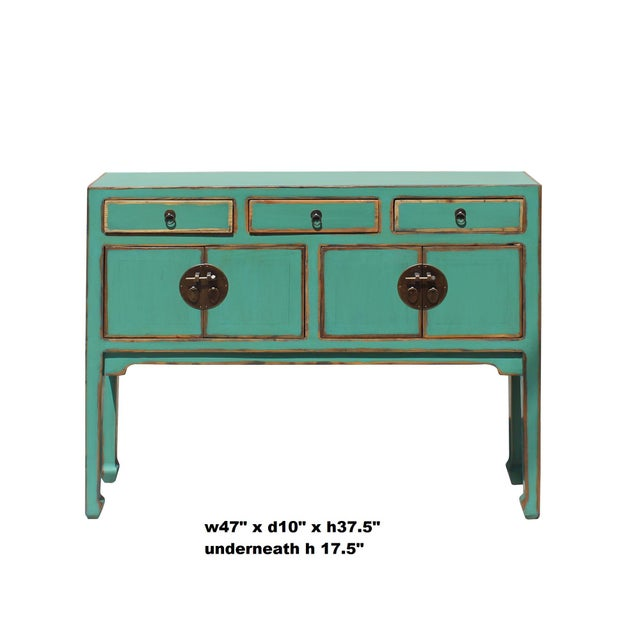 This is a simple narrow slim table with thin legs and small drawers. It is finished with rustic distressed teal green-blue...