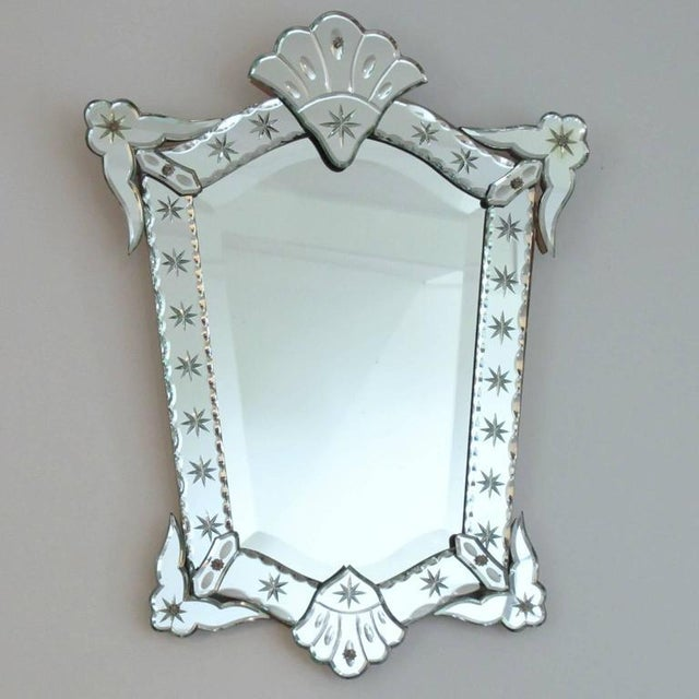 Elegant 1940s French wall mirror. Venetian-style shape with beveled edges all around and star etching design. Geometric...