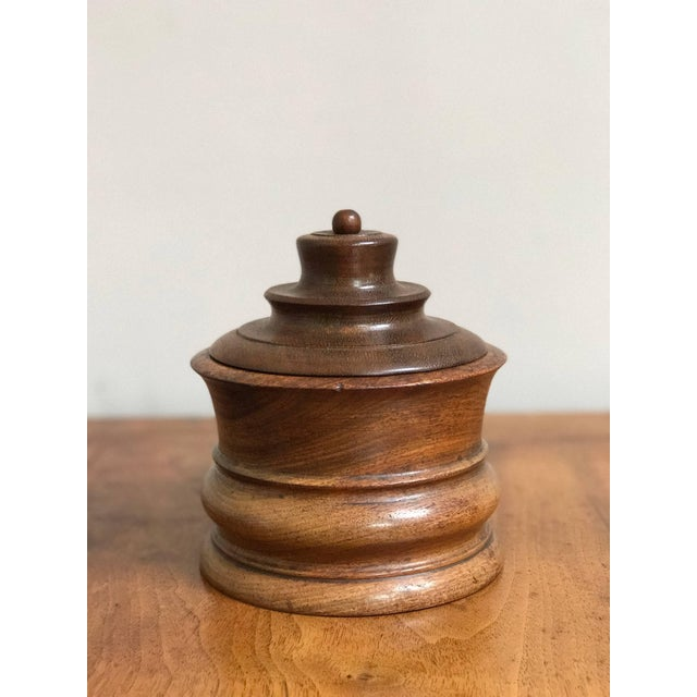 Wooden tobacco jar from late 19th century Belgium.