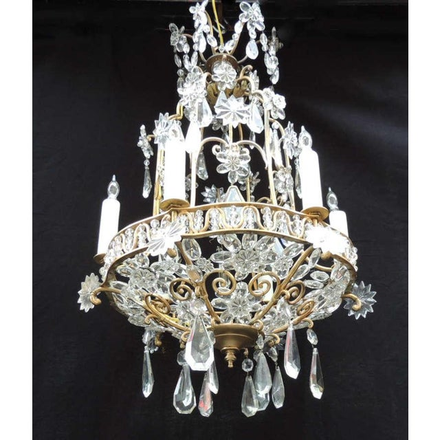 This chandelier was made in France during the early-20th century, circa 1910. This piece has a bronze base with a birdcage...