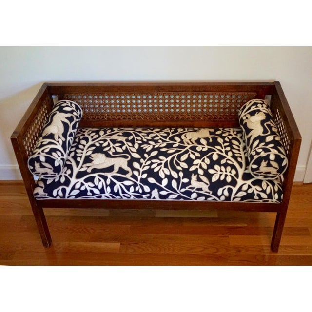 This lovely vintage mid century cane settee is precious. Newly upholstered in Robert Allen fabric with bolster pillows to...