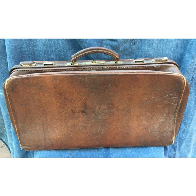 Fantastic vintage 1940's English leather suitcase purchased at an estate sale in Oxfordshire U.K. The suitcase features...