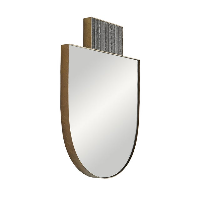 NEW RELEASE! The Lianna Mirror's unique shape is a statement in itself but combined with a hammered, gold-finished iron...