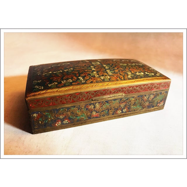 Gorgeous champleve box decorated with multicolored enamel. The original wood liner is still fully intact! Brass has a...