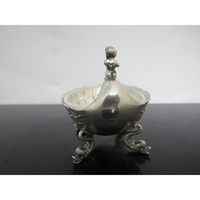 Fantastic antique German .800 silver salt cellar or bowl with glass removable insert. Figural horn player accent and four...