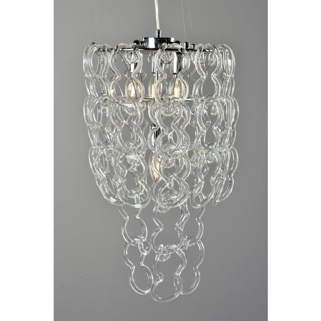 Circa 1970s glass link four light chandelier by Mangiarotti for Vistosi. Forty-eight glass links can be arranged in a...