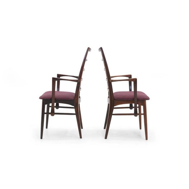 Pair of rosewood dining or side chairs designed by Niels Koefoed. Great set to add as captions chairs to an existing set...