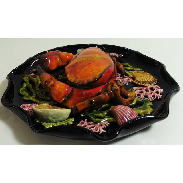 Large Majolica wall platter attributed to Vallauris, circa 1950. A large crab in high relief on the center surrounded by...