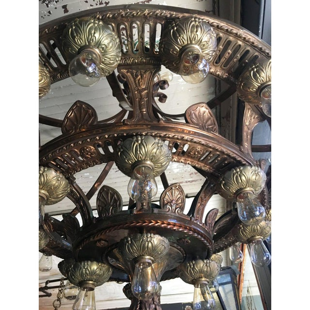REPRODUCTIONS ONLY Magnificent Beaux Arts style, tiered, circular hanging fixture having frame with foliate, guilloche and...