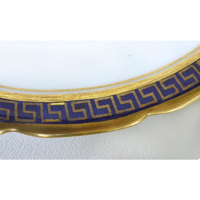 Offered for sale is a Mid-century cobalt blue & gold appetizer or dessert set by Jackson & Coslinc , England. The large...