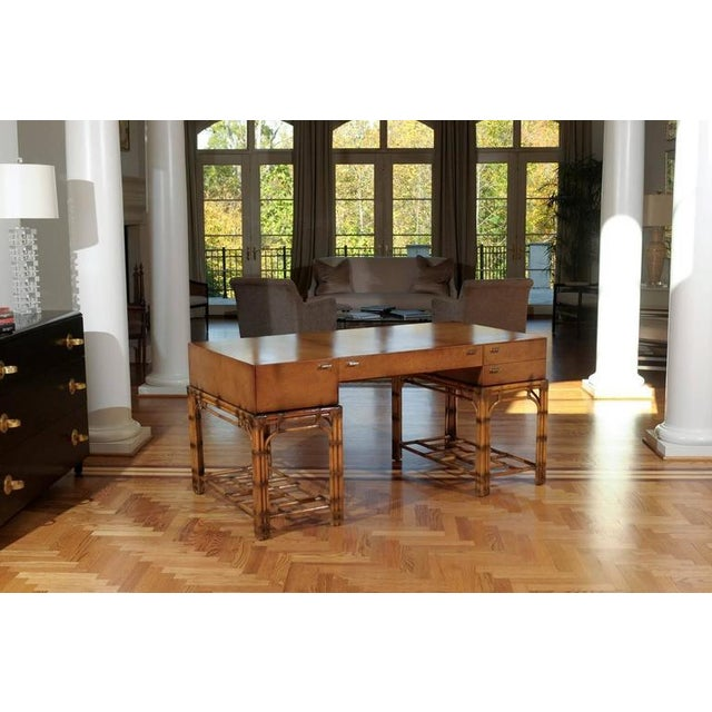 A stellar vintage double pedestal campaign style desk by Henredon, circa 1975. Beautiful hardwood top veneered in...