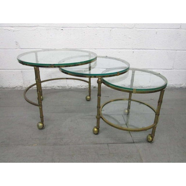 Brass faux bamboo nesting tables which expands to a coffee table. Table can be positioned in many ways. Maison Baguès...