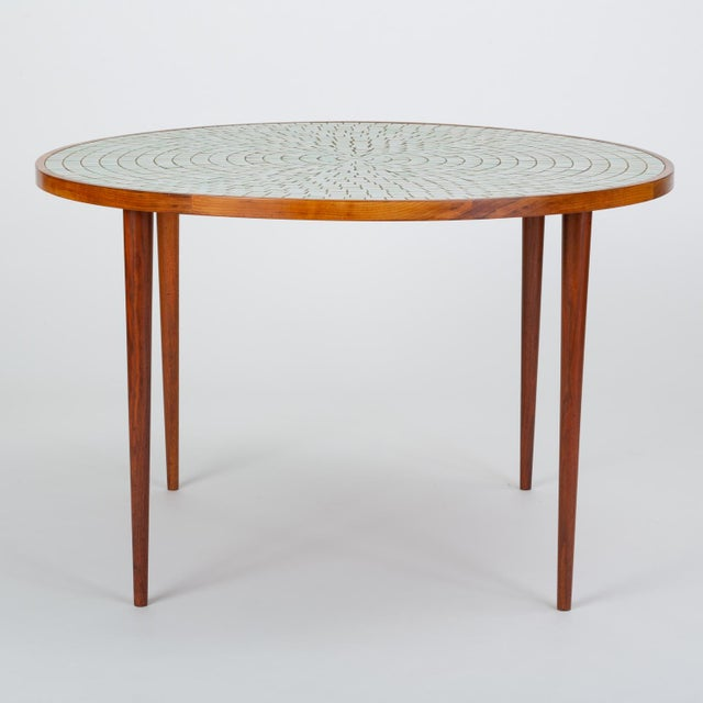 A round dining table from designer husband-and-wife team, Gordon and Jane Martz for their family company Marshal Studios....