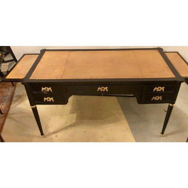 Exquisite Ebony Louis XVI inspired ebonized leather top desk having fine bronze-mounted decorations. The bronze sabots...