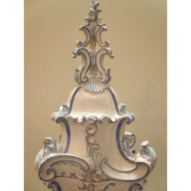 Beautiful Italian handcrafted ceramic terracotta parlor stove of white and blue glaze in Renaissance Revival style has...