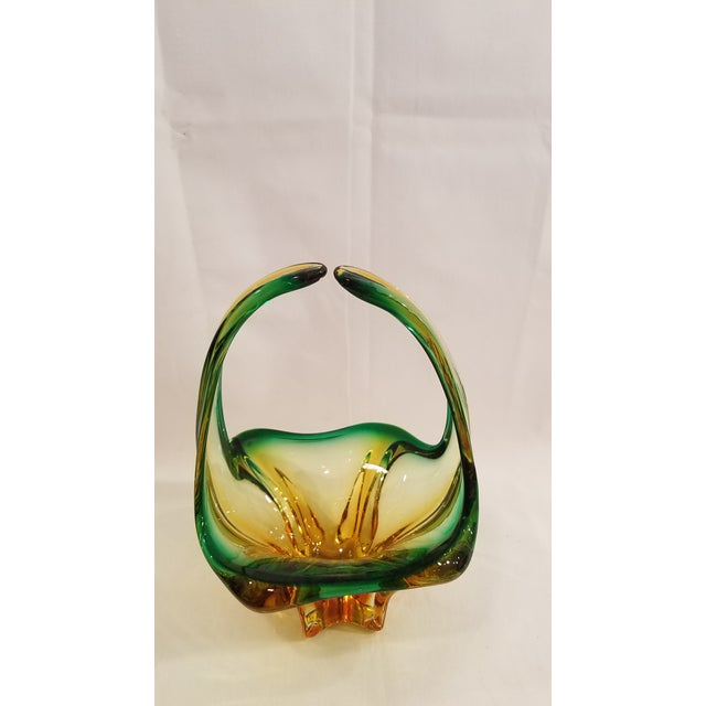 Here is a beautiful Murano blown glass basket. The glass is green and gold cerating a star effect when you look down at...