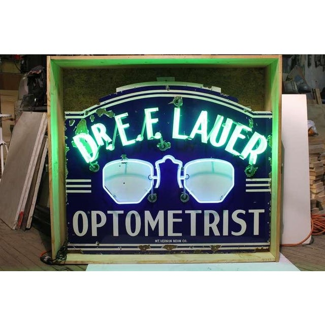 "1930's original enamel sign with new neon sign "" Optometrist "". New wiring."