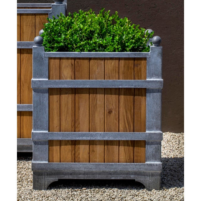 An elegant planter of oak with Zinc coated Steel. This listing is for the planter only. No plants are included with purchase.
