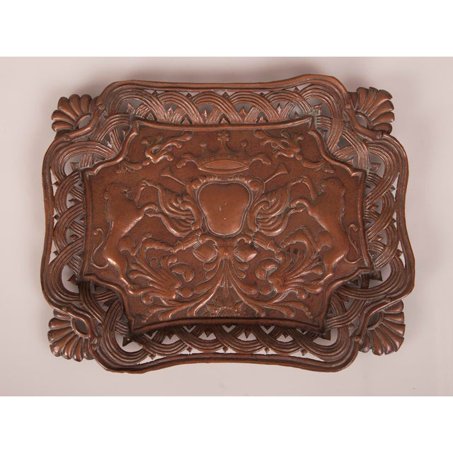 This antique French pressed copper rectangular tray circa 1890 features a pair of heraldic lions rampant beneath a full...