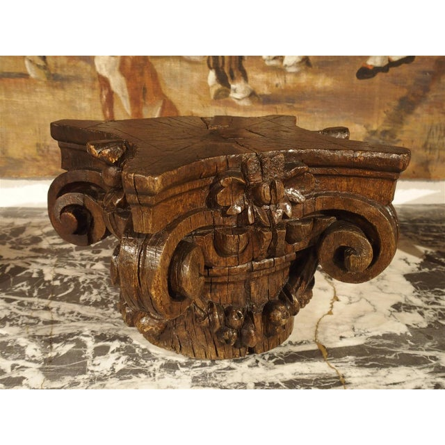 This French, hand carved Ionic capital has been carved out of European Oak. The motifs are single flowers at the top...
