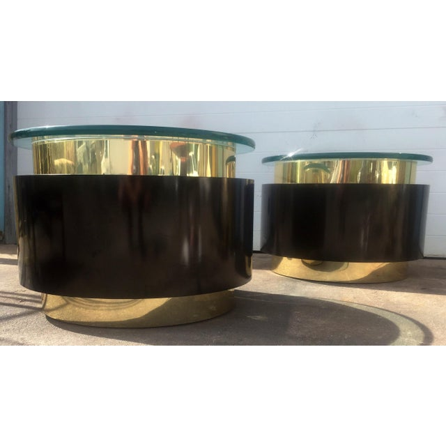 This listing is for a pair of gold and black glass top tables. Condition-good vintage condition with signs of wear as...