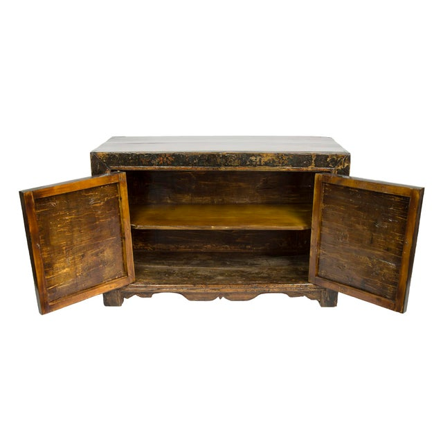 Add elegant sophistication to your decor with this stunning Mongolian antique 2-door floor cabinet, circa 1900. This...
