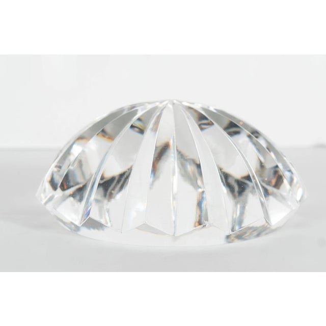 This beautiful faceted crystal paperweight by Baccarat features 16 segments of cut crystal in radial symmetry. It would...