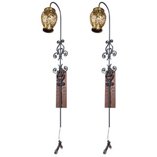 Pair of Tall Wrought Iron Wall Sconces With Hanging Brass Moroccan Lanterns For Sale