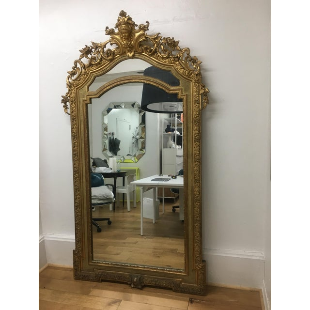 Perfectly proportioned ornate gilt floor or wall mirror. Originally from Europe, salvaged from a hotel that was demolished.