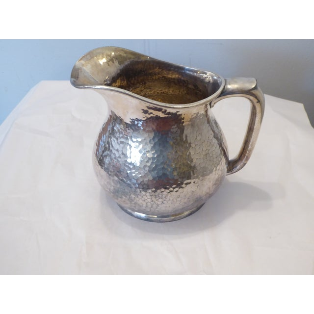 Vintage Reed & Barton hammered silvered pitcher, with mark on the underside.