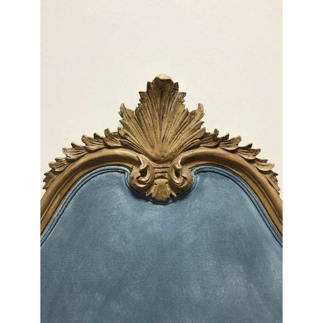 Carved yellow pine carved queen size headboard with a very light pigment of color deposited in the finish. Not sure of its...