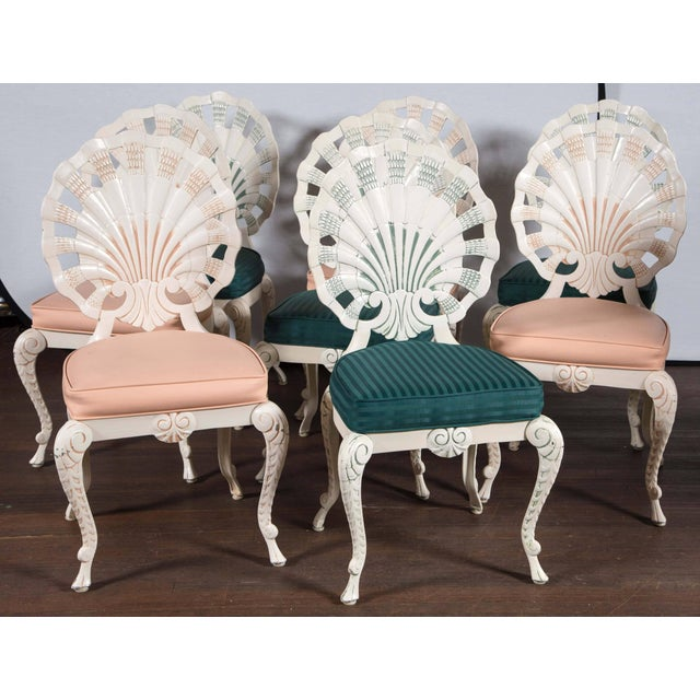 Measures: 18.5 seat height, 18.25 back width. Two sets of four grotto shell back dining chairs.