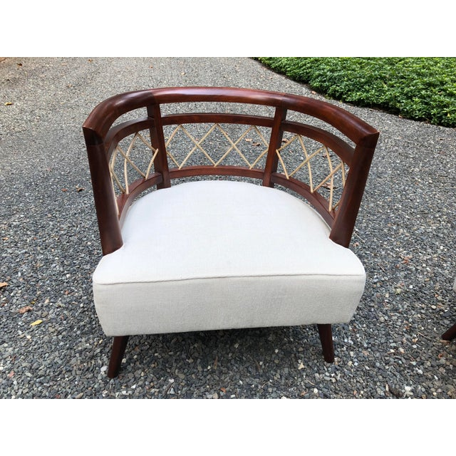 Stunning pair of barrel back occasional chairs by Milo Baughman (attributed). Mahogany frames and reed detail in diamond...
