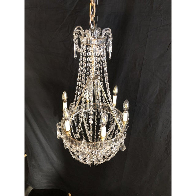 Beautiful bronze and Crystal Louis XVI Style Traveling Chandelier. Rewired and electrified. Circa 1870's. In the 18th and...