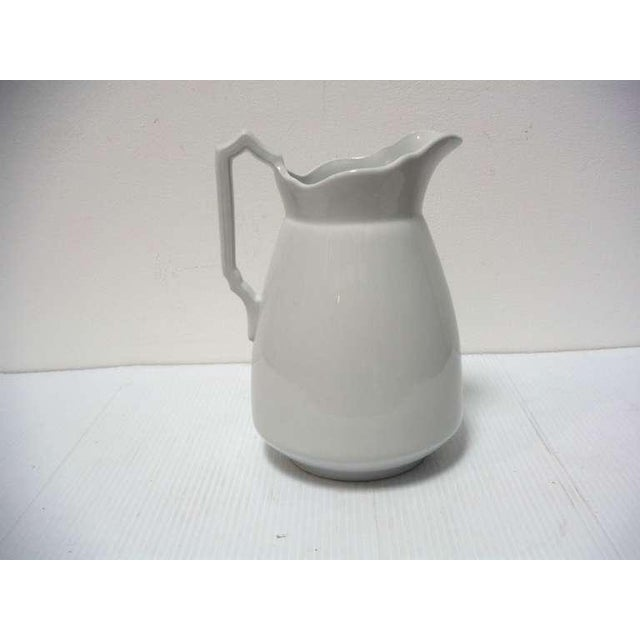 Early signed England Ironstone water pitcher in great condition. Great as display or for flowers on a table.