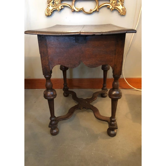 19th century antique William and Mary Revival English oak table with one drawer. There are many wonderful features to this...