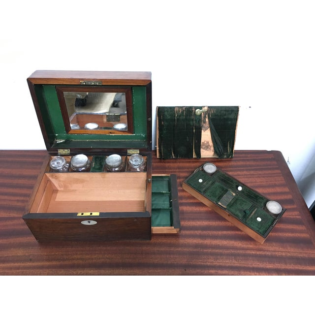 Wonderful gentleman's dressing table set in gorgeous Rosewood box with mother of pearl accents. Four larger cut glass...