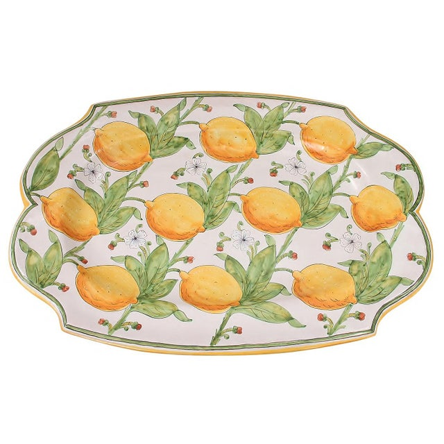 Hand made Italian ceramic lemon platter. This large scalloped platter is beautifully hand painted with lemons, buds, and...