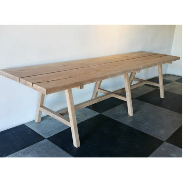 Benchmade by OZSHOP woodworkers in Scottsdale, Arizona. Solid wood trestle table made with two monkey pod plank tops....