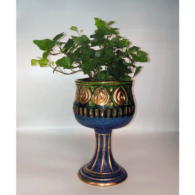 A deep blue with green and gold chalice vase by Rosenthal.