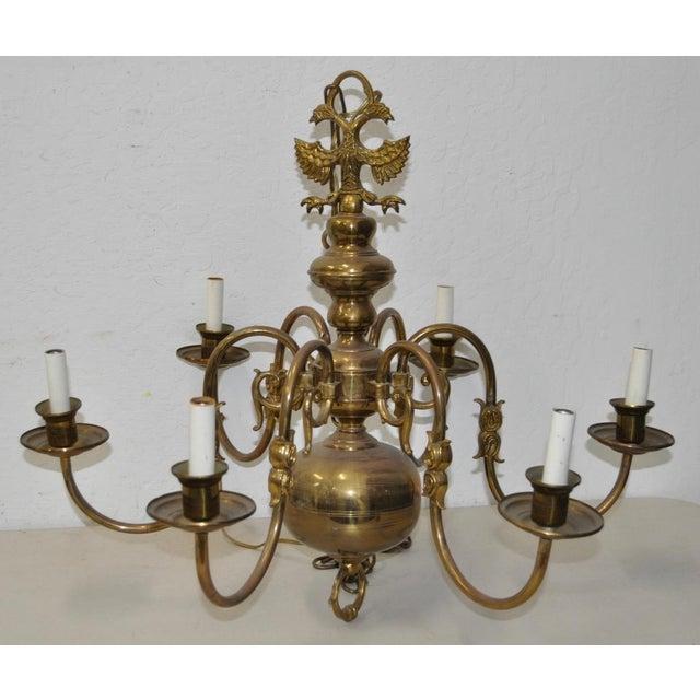 Six Arm Brass Chandelier c.1940s Beautiful brass Berunda chandelier with six arms. The Berunda is a two-headed...